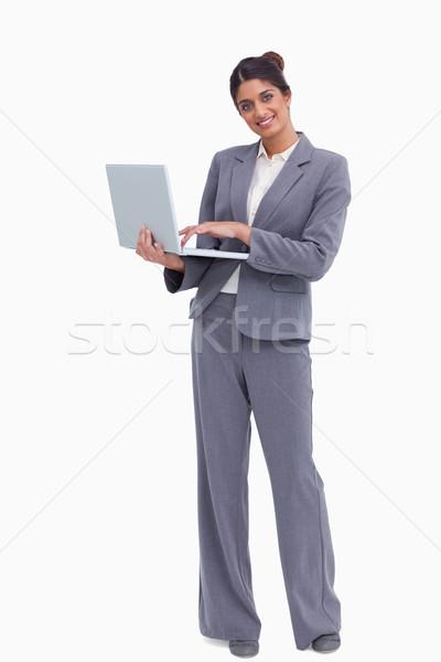 Smiling female entrepreneur with her laptop against a white background Stock photo © wavebreak_media