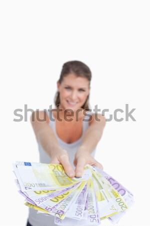 Portrait femme souriante banque note blanche Photo stock © wavebreak_media