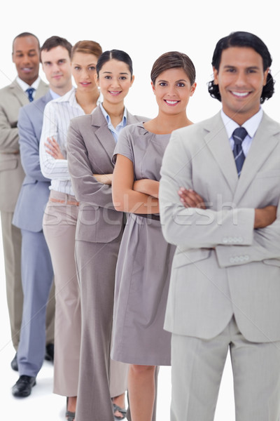 Close-up of a business team in a single line crossing their arms with focus on the first woman Stock photo © wavebreak_media
