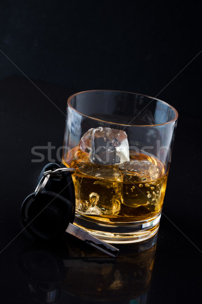 Whiskey on the rocks and car key against a black background Stock photo © wavebreak_media