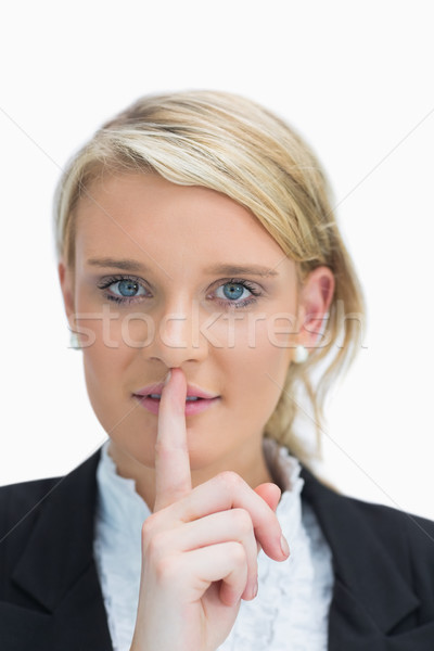 Businesswoman making quiet sign Stock photo © wavebreak_media