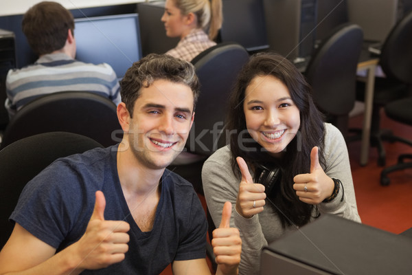 Happy students giving thumbs up in computer class Stock photo © wavebreak_media