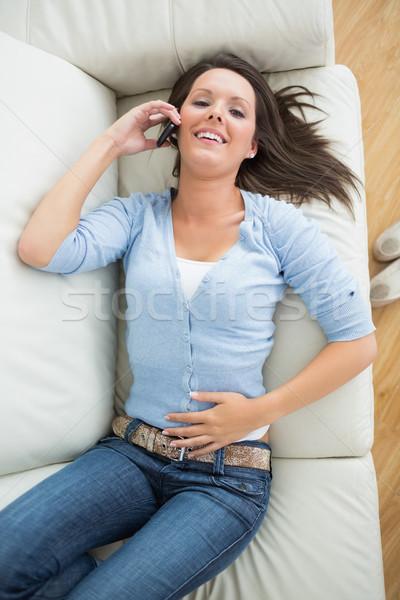 счастливым женщину призыв диване гостиной улыбка Сток-фото © wavebreak_media