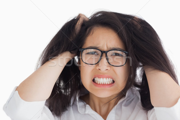 Worried woman putting her hand on the head in the white background Stock photo © wavebreak_media