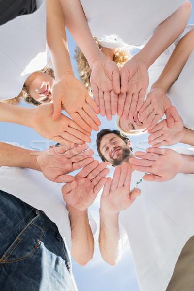 Boldog önkéntesek kezek együtt kék ég alulról fotózva Stock fotó © wavebreak_media