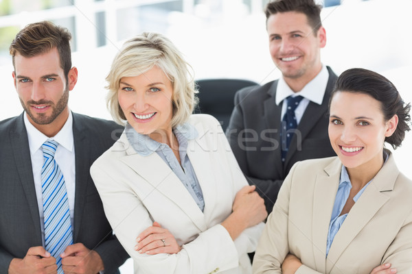 Confident business team with arms crossed in office Stock photo © wavebreak_media