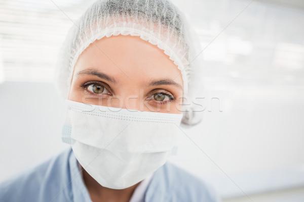 Female surgeon wearing surgical cap and mask Stock photo © wavebreak_media