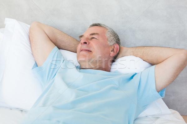 Idős férfi nap álmodik ágy kezek Stock fotó © wavebreak_media
