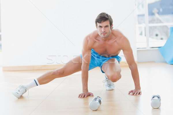 Sporty shirtless man exercising in fitness studio Stock photo © wavebreak_media