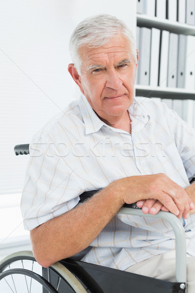 Portrait of a sad senior man sitting in wheelchair Stock photo © wavebreak_media