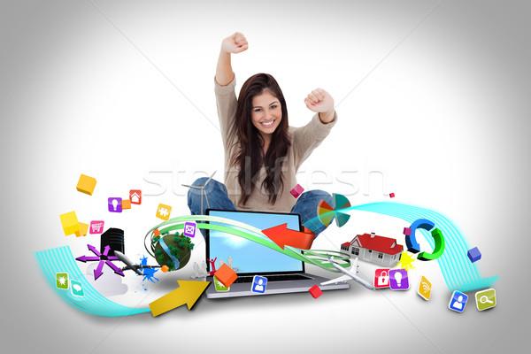 Fille utilisant un ordinateur portable app icônes composite numérique Photo stock © wavebreak_media
