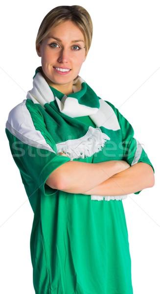 Pretty football fan in green jersey Stock photo © wavebreak_media