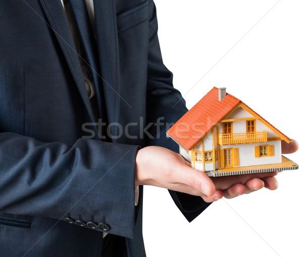 üzletember tart miniatűr ház modell fehér Stock fotó © wavebreak_media