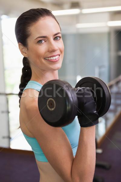 Mosolygó nő emel nehéz súlyzó tornaterem boldog Stock fotó © wavebreak_media