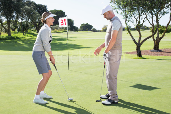 Senhora jogador de golfe verde buraco parceiro Foto stock © wavebreak_media