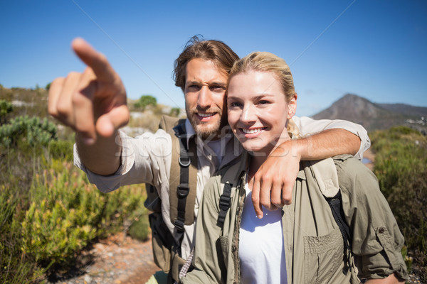 Happy hiking couple walking on mountain terrain  Stock photo © wavebreak_media