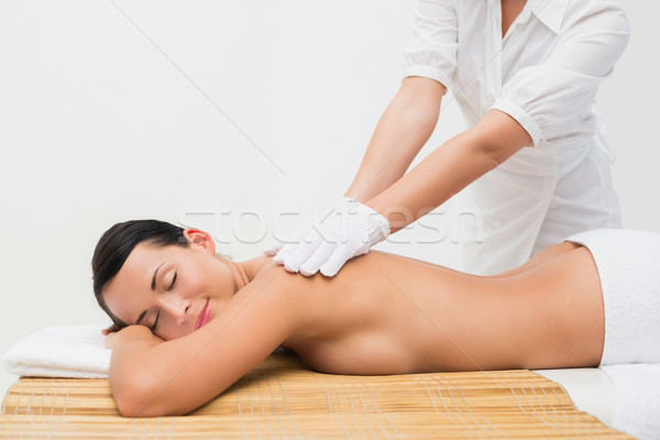 Beautiful brunette enjoying an exfoliating back massage Stock photo © wavebreak_media