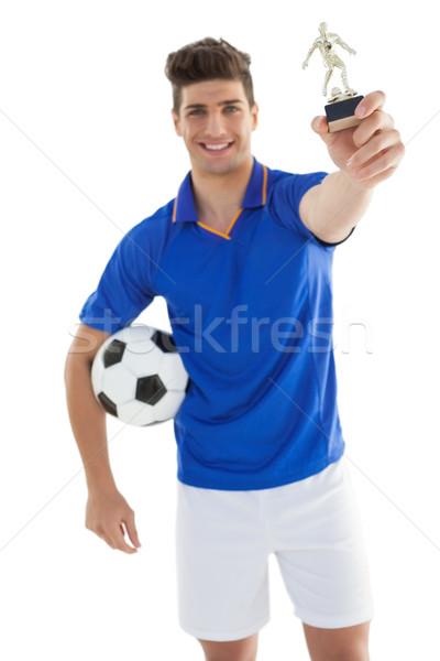 Futbolista ganadores trofeo blanco feliz Foto stock © wavebreak_media