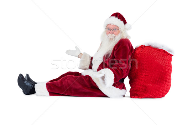 Santa sits leaned on his bag and has no clue Stock photo © wavebreak_media