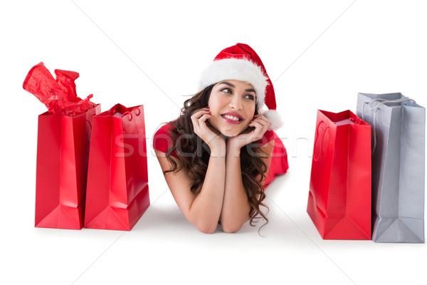 Festive brunette lying with shopping bags  Stock photo © wavebreak_media