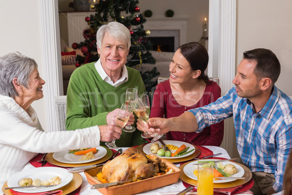 Portrait of happy family toasting at christmas dinner Stock photo © wavebreak_media