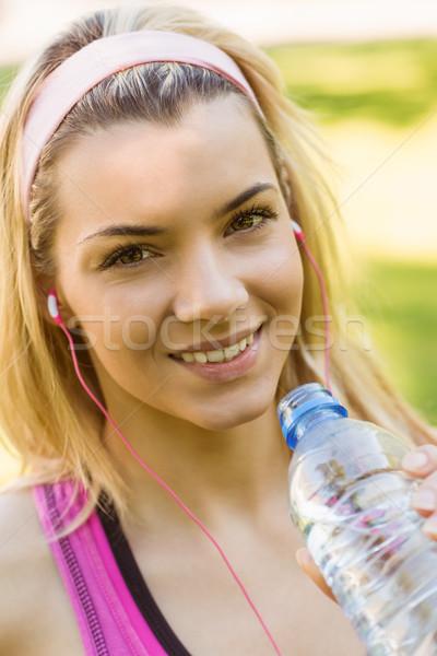 Fit blonde drinking from her water bottle Stock photo © wavebreak_media