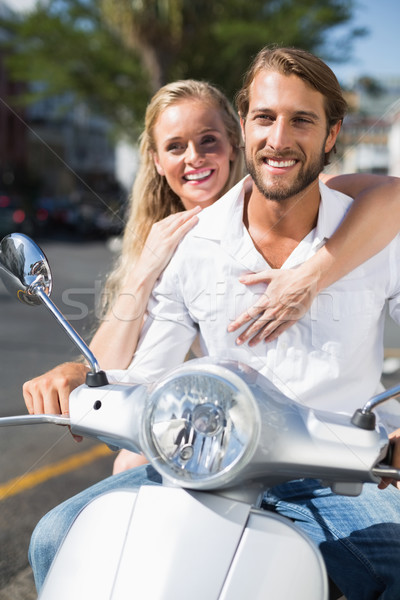 Stock photo: Attractive couple riding a scooter