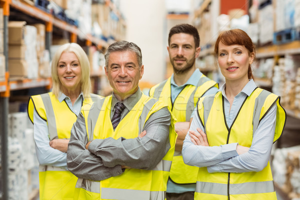 Smiling warehouse team with arms crossed Stock photo © wavebreak_media