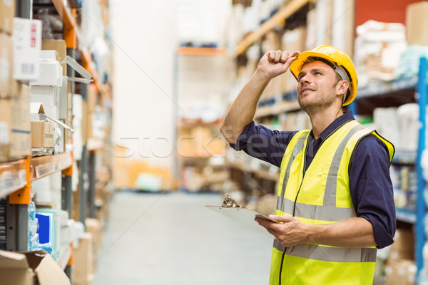Portrait of warehouse worker with clipboard Stock photo © wavebreak_media