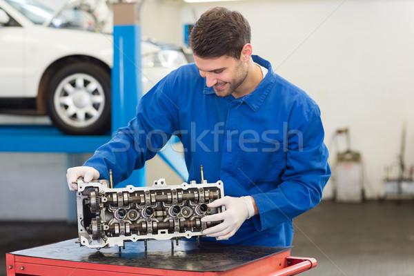 Smiling mechanic working on engine Stock photo © wavebreak_media