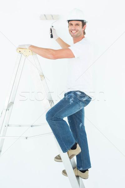 Retrato homem escada pintura feliz Foto stock © wavebreak_media