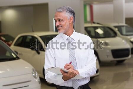 笑みを浮かべて ビジネスマン 見える カメラ 新しい車 ショールーム ストックフォト © wavebreak_media