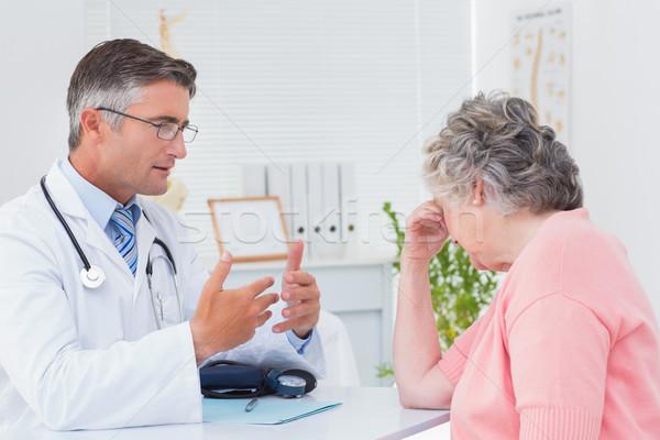 Doctor talking to tensed patient Stock photo © wavebreak_media