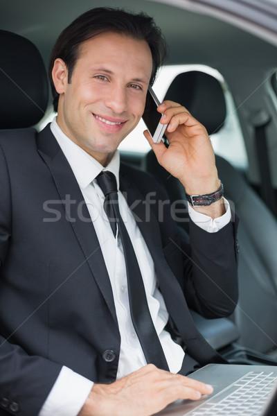 Empresário trabalhando assento carro feliz tecnologia Foto stock © wavebreak_media