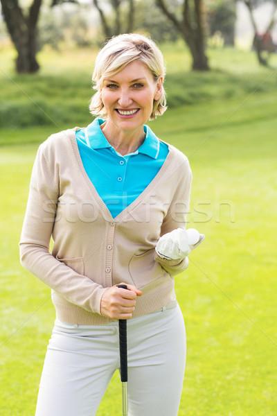 Derűs golfozó mosolyog kamera tart klub Stock fotó © wavebreak_media
