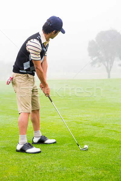 Concentrate golfer lining up his shot Stock photo © wavebreak_media