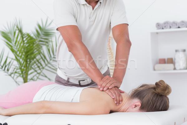 Szyi masażu pacjenta medycznych biuro kobieta Zdjęcia stock © wavebreak_media