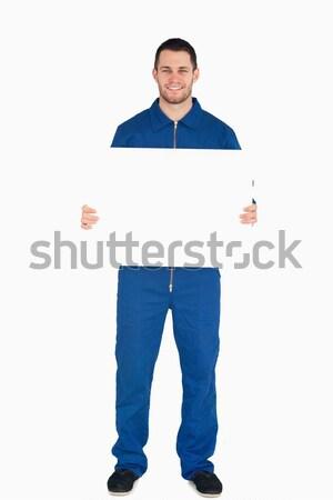 Businessman holding a white sign Stock photo © wavebreak_media