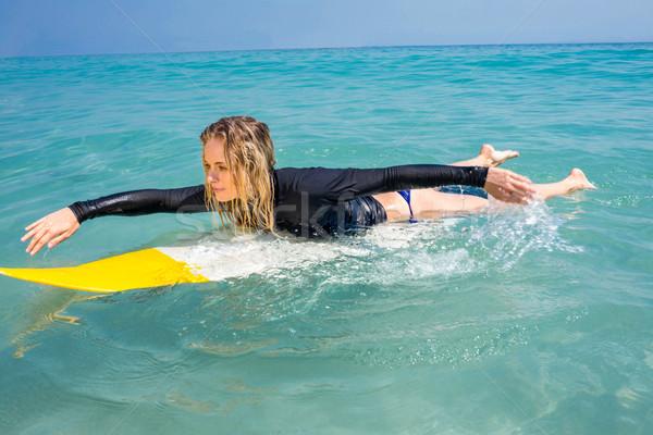 Nő szörfdeszka napos idő tengerpart boldog sport Stock fotó © wavebreak_media