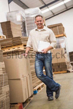 Smiling manager with arms crossed in warehouse Stock photo © wavebreak_media