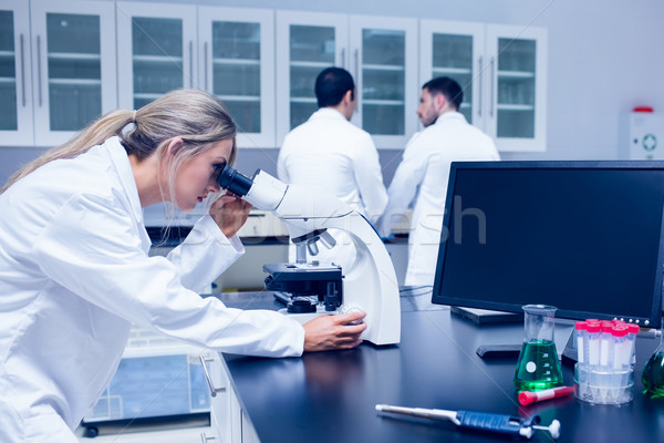 Science student working with microscope in the lab Stock photo © wavebreak_media