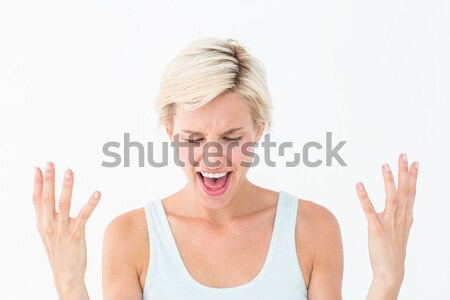 Angry blonde yelling with hands up  Stock photo © wavebreak_media