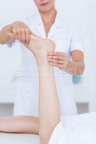 Physiotherapist doing foot massage Stock photo © wavebreak_media