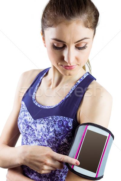 Fit woman using smartphone in armband Stock photo © wavebreak_media