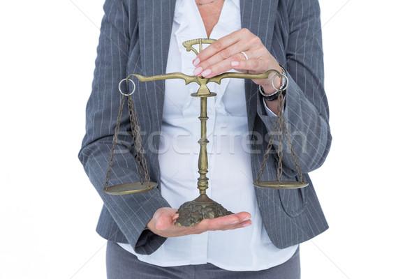 businesswoman holding scales of justice Stock photo © wavebreak_media