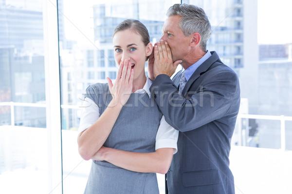 Secretive business colleagues whispering Stock photo © wavebreak_media