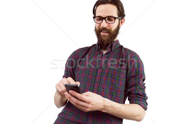 Handsome hipster using his phone Stock photo © wavebreak_media