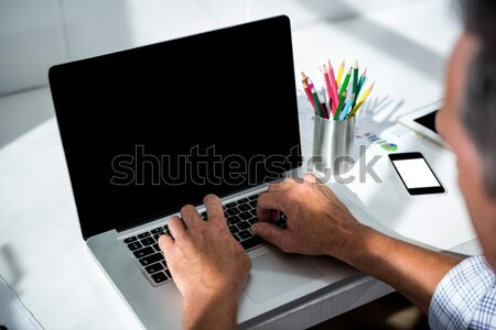 Stock photo: Person using Tablet with Shopping trolley icon