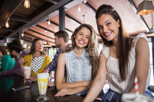 Female friends sitting at restaurant Stock photo © wavebreak_media