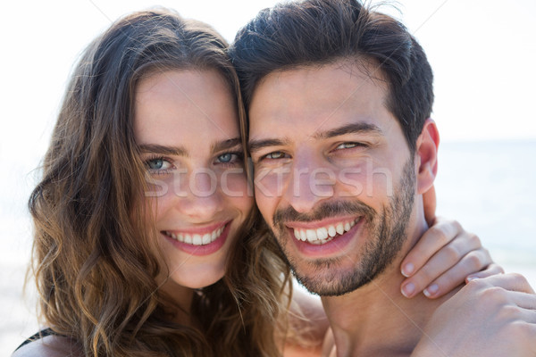 Portrait of smiling couple cheek to cheek Stock photo © wavebreak_media